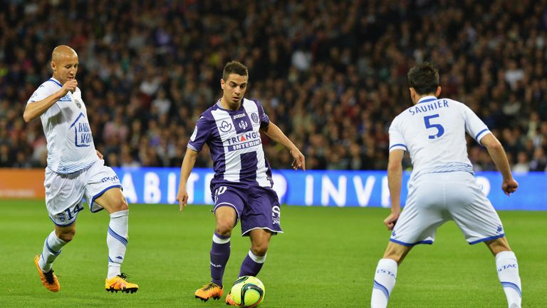 Sevilla sign Toulouse forward Wissam Ben Yedder (centre) on five-year deal