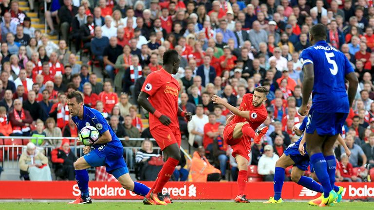 Adam Lallana scores Liverpool's third goal of the game at Anfield