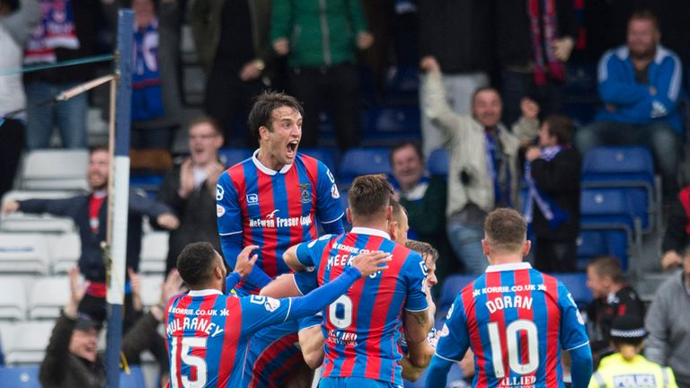 Inverness Caley Thistle's Alex Fisher (hidden) celebrates his goal against Celtic