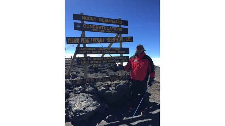 Barrie McDermott at the top of Kilimanjaro
