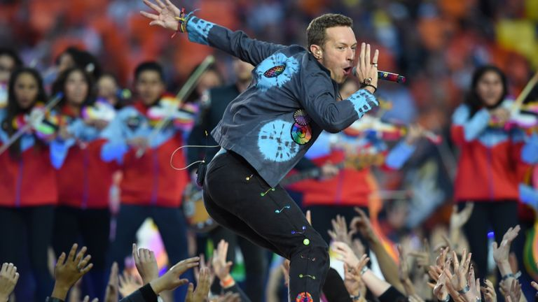 Chris Martin of Coldplay performs at the half-time show of Super Bowl 50