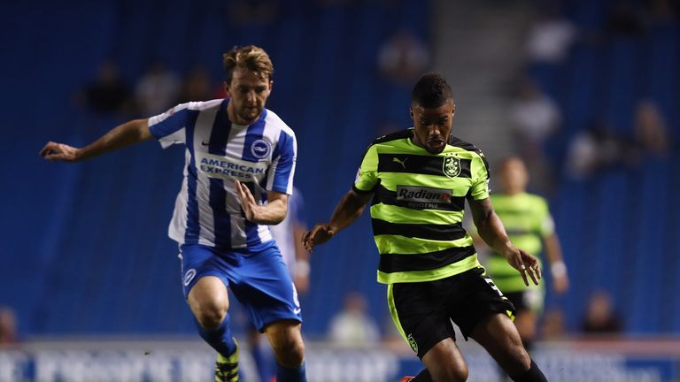 Elias Kachunga of Huddersfield (right) is challenged by Dale Stephens