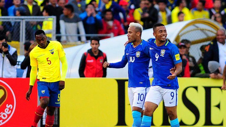 Jesus (r) celebrates with Neymar Jr (c) after scoring against Ecuador