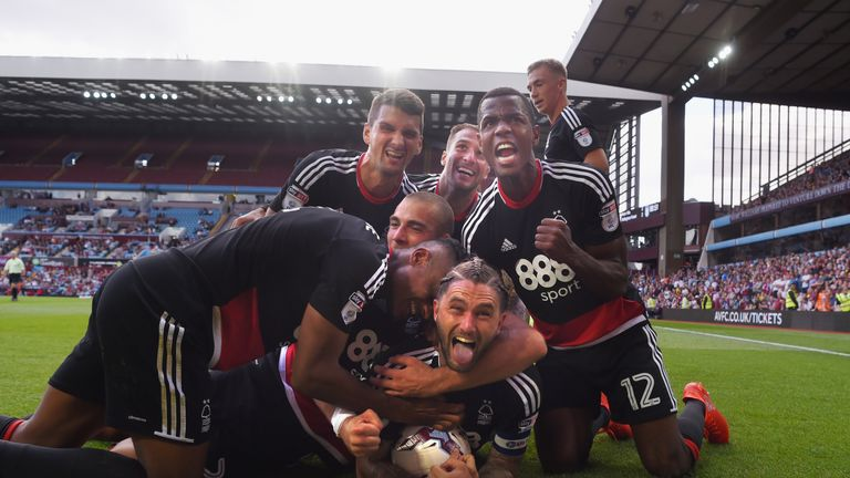 Henri Lansbury celebrates his late equaliser against Aston Villa