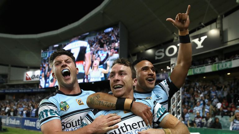 James Maloney of the Sharks celebrates with his team-mates after scoring a try against North Queensland