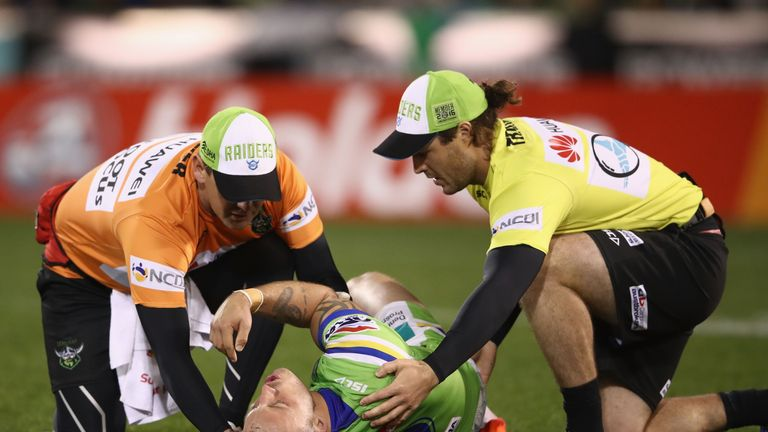 Josh Hodgson of the Raiders receives attention from a trainer