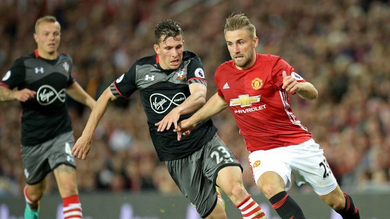 Luke Shaw vies for possession against his old club Southampton
