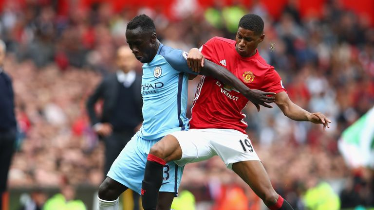 Marcus Rashford gets stuck in on Bacary Sagna after coming off the bench during the Manchester derby