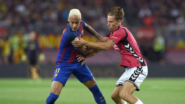 Neymar (left) vies with Raul Garcia, Barcelona v Alaves, La Liga