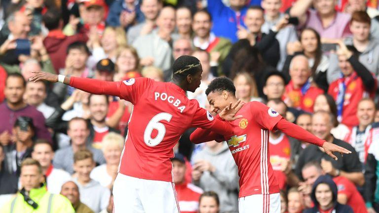 Manchester United midfielder Pogba and Jesse Lingard celebrate