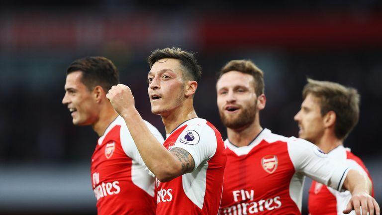Mesut Ozil (C) celebrates scoring Arsenal's third