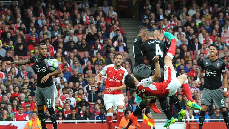 Laurent Koscielny equalises with an overhead kick at the Emirates Stadium