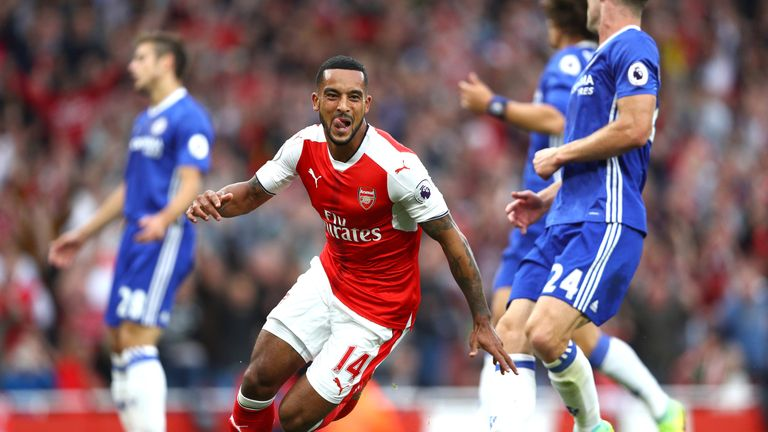 Theo Walcott celebrates scoring Arsenal's second goal
