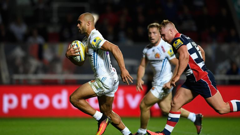 Olly Woodburn races to the line to score against Bristol