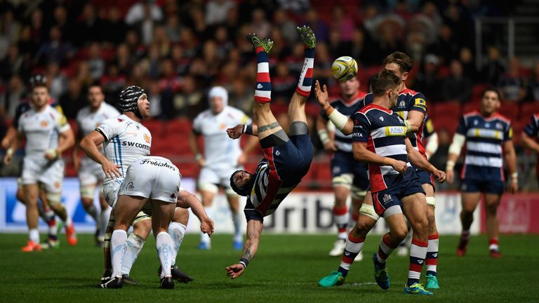 Exeter wing Ian Whitten (left) tackles Ryan Edwards in the air and is sin-binned