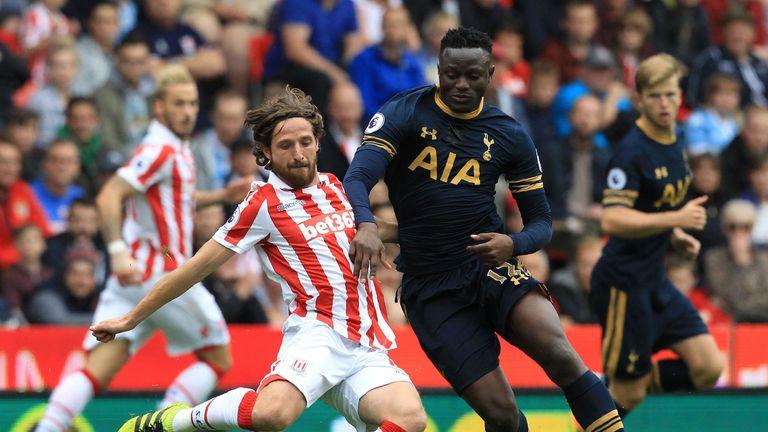 Stoke's Joe Allen tangles with Spurs midifielder Victor Wanyama