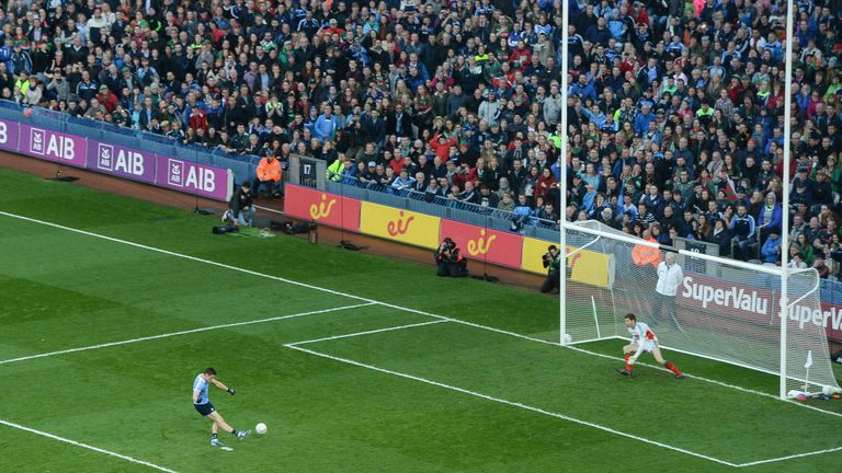 Diarmuid Connolly scores a penalty past David Clarke of Mayo during the GAA Football All-Ireland Senior Championship Final Replay
