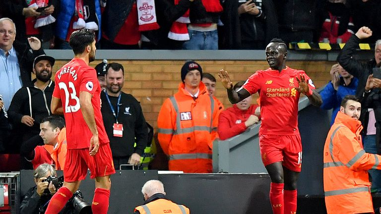 Liverpool's Sadio Mane (right) reacts after scoring his side's first goal of the game