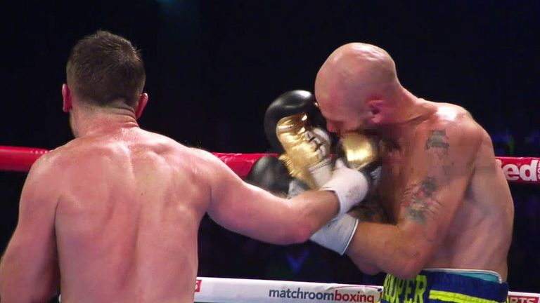 Cardle lands a right hook as Hooper retreats to the ropes