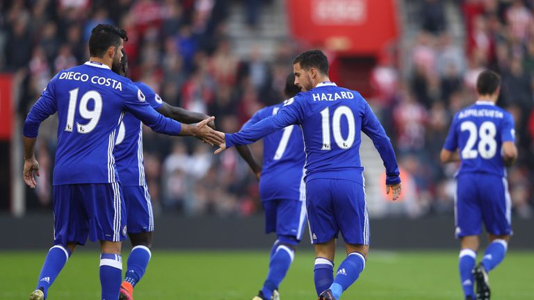 Eden Hazard of Chelsea (R) celebrates scoring his sides first goal
