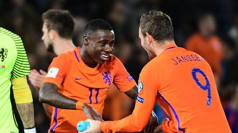 Netherlands' Quincy Promes (C) and Vincent Janssen (R) celebrate