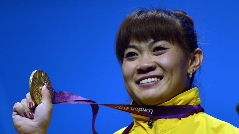 Kazakhstan's Maiya Maneza after winning gold medal for the women's 63kg group