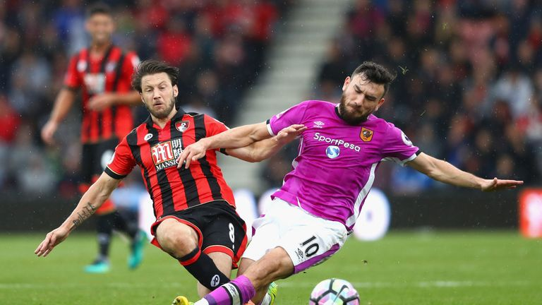 Harry Arter (L) tangles with Robert Snodgrass during Bournemouth's win over Hull City