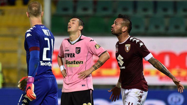 Palermo's Ilja Nestorovski (C) is left frustrated against Joe Hart's Torino
