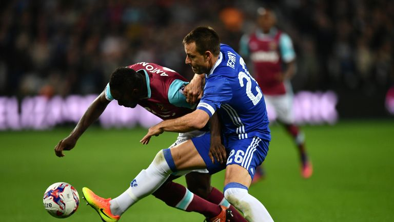 Michail Antonio and John Terry battle for possession
