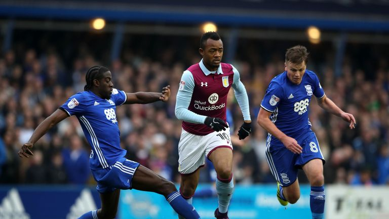 Aston Villa's Jordan Ayew (centre) amd Birmingham City's Clayton Donaldson (left) battle for the ball