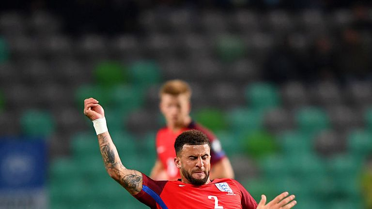 Kyle Walker of England battles for the ball with Jasmin Kurtic of Slovenia