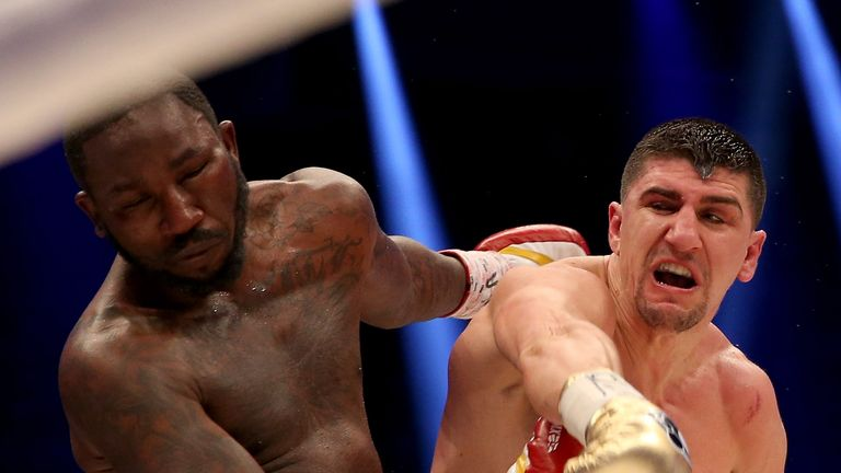 Marco Huck stopped Ola Afolabi in 10 rounds to win the IBO title