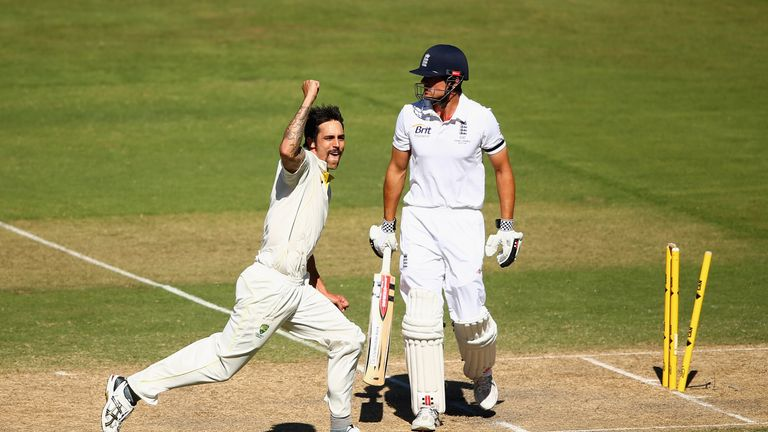 Mitchell Johnson (L) celebrates the wicket of Cook, one of his 37 victims in the 5-0 Ashes whitewash in 2013/14