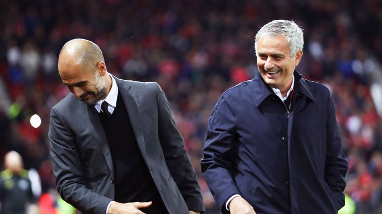 Pep Guardiola and Jose Mourinho share a joke at Old Trafford last year