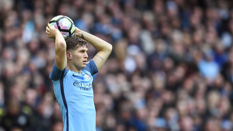 John Stones prepares to take a throw-in for City