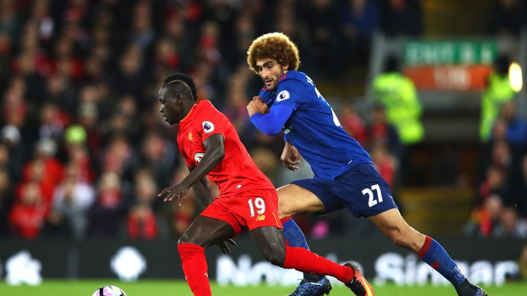 Sadio Mane takes on Marouane Fellaini in the first half