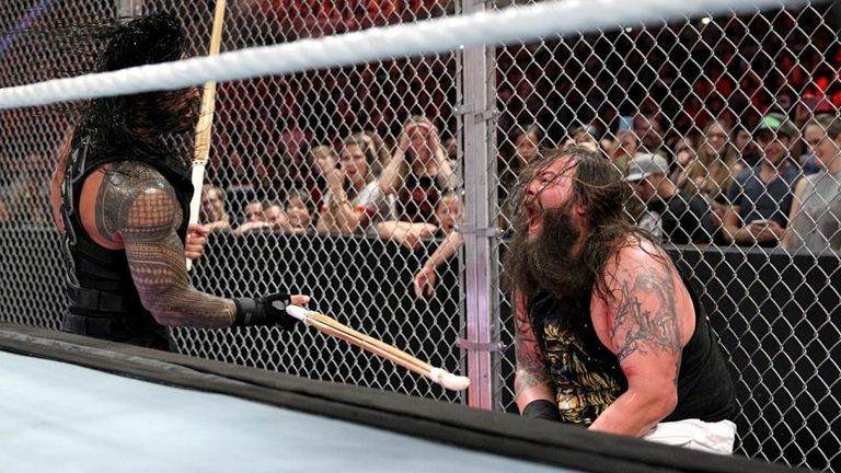 Roman Reigns pummels Bray Wyatt at Hell in a Cell 2015