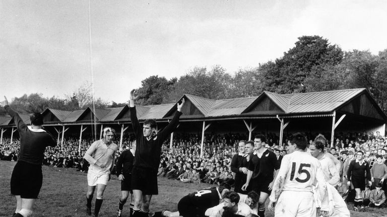 Colin Meads (middle) celebrates a New Zealand try in October 1963