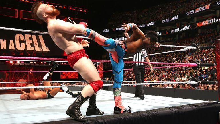 Sheamus is kicked by Xavier Woods during tag-team action