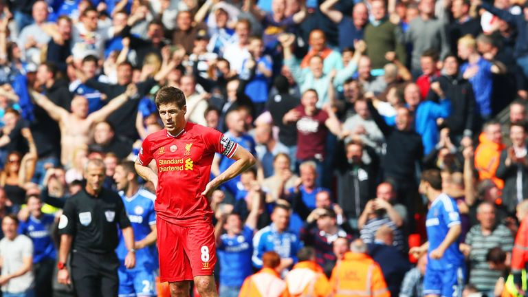 Gerrard looks dejected as his mistake hands Chelsea a crucial goal at Anfield in April 2014