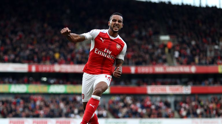 Theo Walcott celebrates after doubling his tally against Swansea