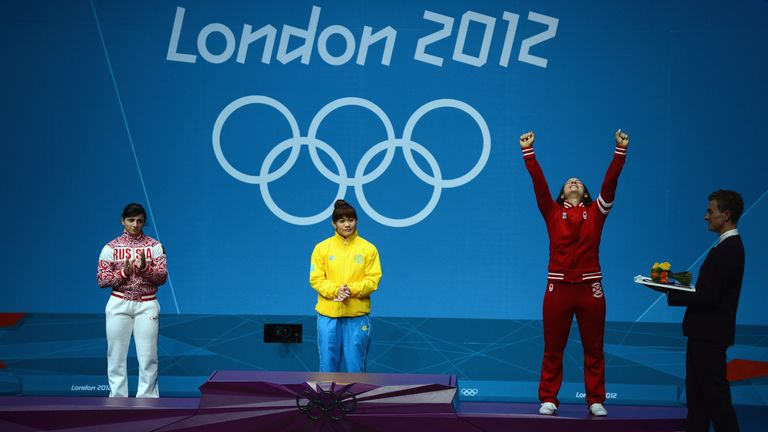 Christine Girard  (right) stands to win silver from London 2012 Games