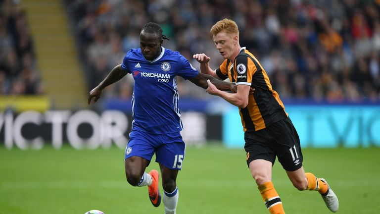 Victor Moses holds off Sam Clucas during Chelsea's win at Hull