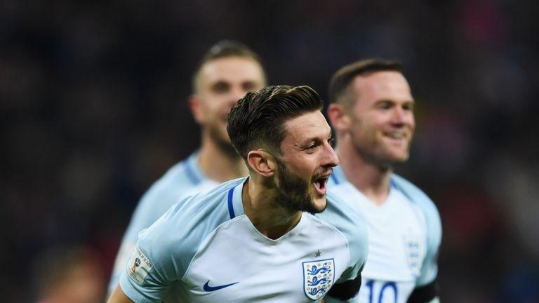 Adam Lallana celebrates his goal against Scotland on Friday night