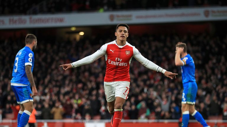 Arsenal's Alexis Sanchez celebrates scoring his side's third goal
