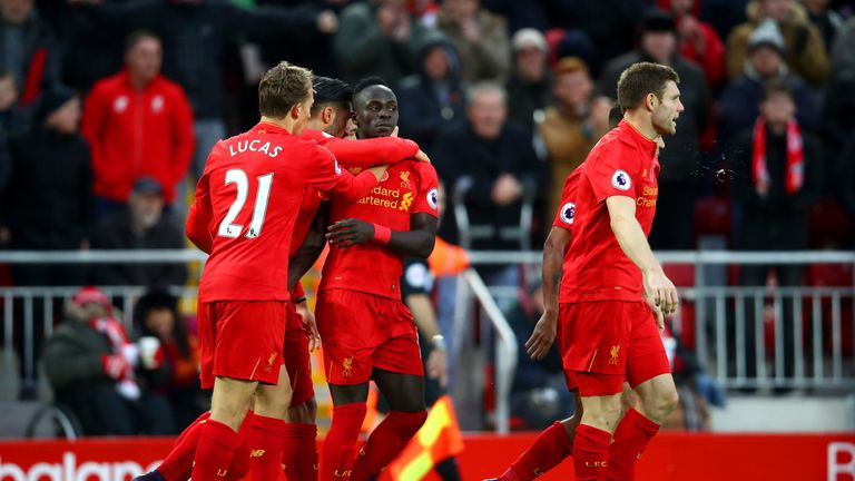 Sadio Mane celebrates scoring his second goal and Liverpool's fifth