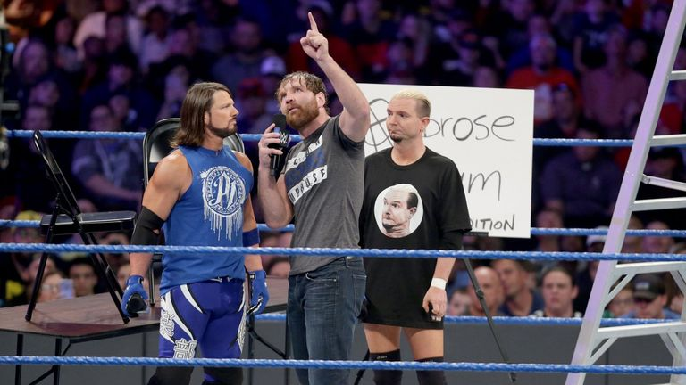 Dean Ambrose points at the prize he and Styles will be fighting for at TLC
