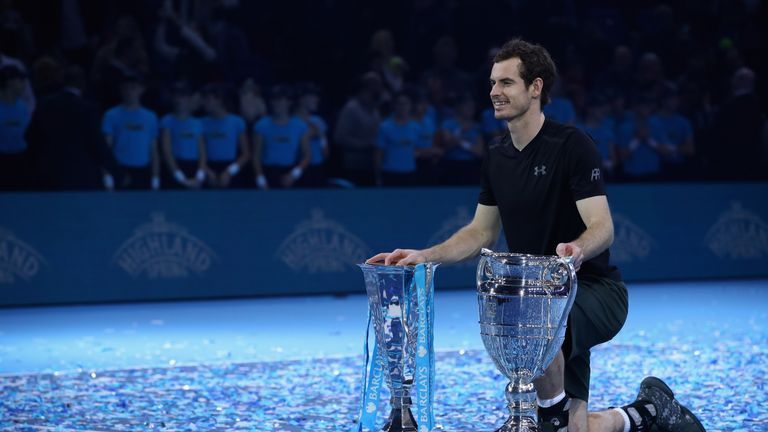 Murray poses with the ATP Tour Finals trophy and the year end world No 1 trophy