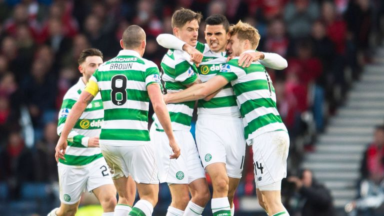 Celtic players celebrate the opening goal at Hampden from Tom Rogic