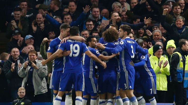 Chelsea players celebrate after Victor Moses scored their second goal against Tottenham